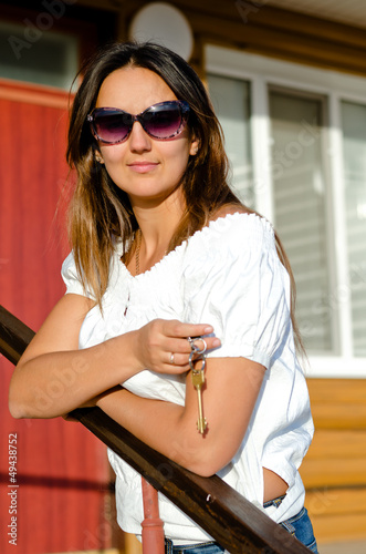 Attractive woman holding a house key