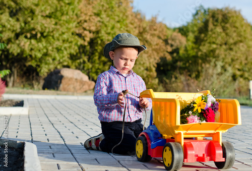 Cute little boy with a toy truck
