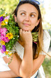 Beautiful woman with flowers daydreaming