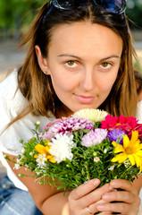 Beautiful woman with colourful flowers