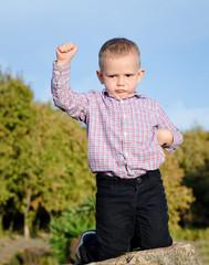 Triumphant little boy