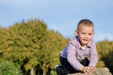 Happy little boy exploring outdoors