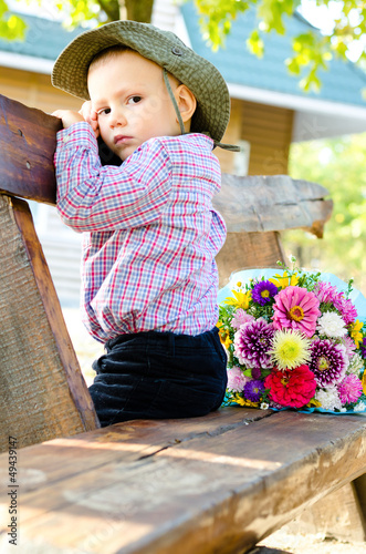 Little boy with a bouquet of flowers
