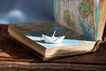 Paper boat and map.
