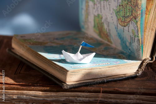 Paper boat and map. - 49440577