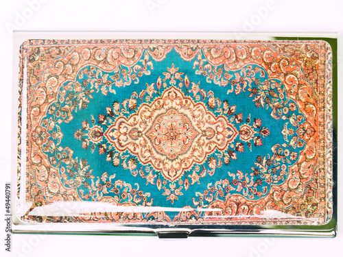 A colorful arabesque patternon the metalic business card cover i