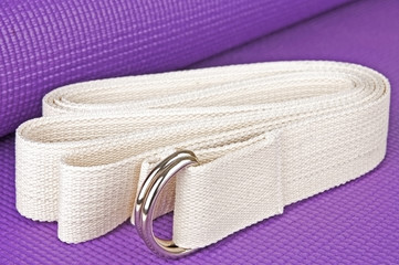 Strap for yoga practice on yoga mat background