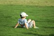 child relaxing on grass