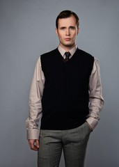 Man in vest isolated on grey background