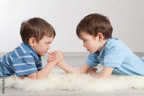 Arm wrestling and two brothers,