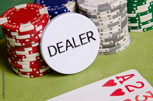 Dealer button and chips