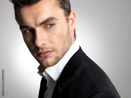 Closeup face of a fashion businessman in suit