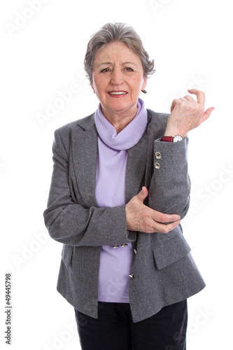 Ältere Frau mit Schmerzen am Armgelenk