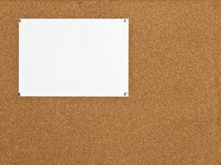 sheet of paper on cork board