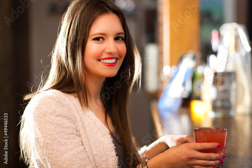 Woman having a drink in a pub