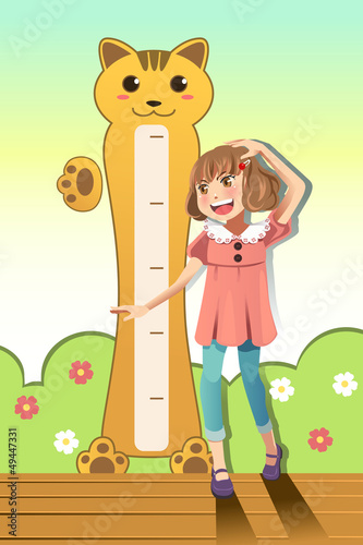Girl measuring her height