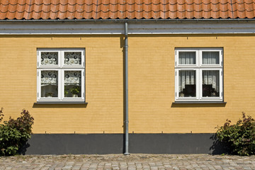 Danish village, old house with windows. Denmark.