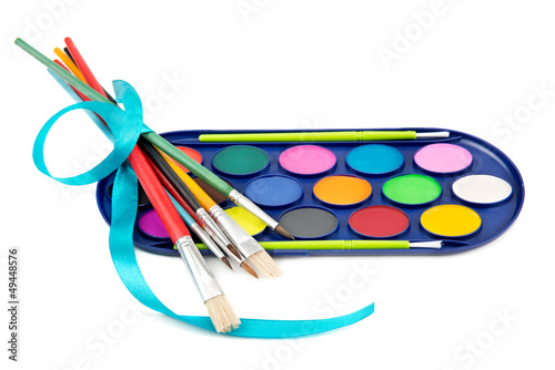 kit of watercolor paints and brushes for painting