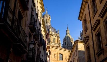 Skyline of Salamanca from a dark alley