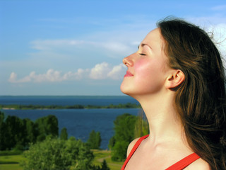 portrait of young attractive  woman in the nature background