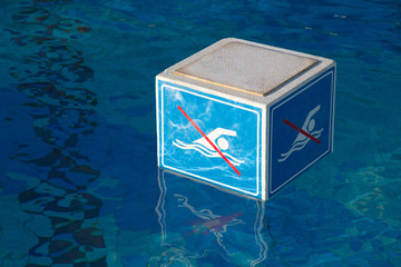 Swimming  prohibition sign in a swimming pool