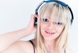 Cheerful girl listening to music with blue headphone