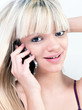 Attractive teen girl smiling while phoning
