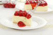 Fork cutting cherry cheesecake