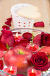 Valentine candles, apple, coffee cup and rose petals
