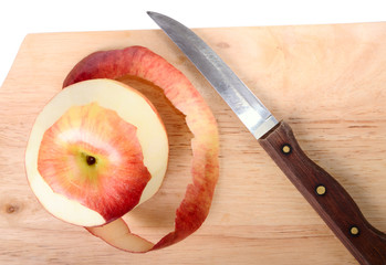 Red apple, peel and knife