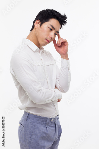Thinking young Asian man