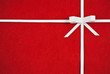 Hand made ribbon and bow on red  paper as background