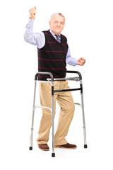 Happy mature gentleman with walker gesturing happiness