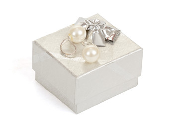 two pearl earrings and gift box isolated on white