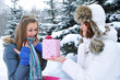 Young beautiful girls in winter with a gift