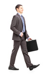 Full length portrait of a young businessman with briefcase walki poster