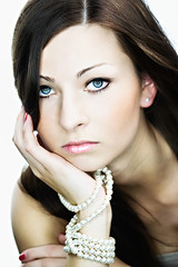 beautiful woman portrait with white pearls
