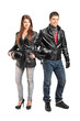 Full length portrait of two young motorcyclers in a leather jack