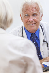 Senior Male Doctor With Female Patient
