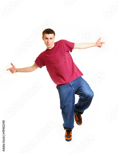 Cool breakdance style dancer posing on studio background