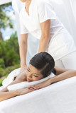Woman Relaxing At Health Spa Having Massage