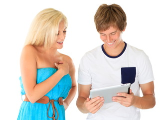 Young man showing girl his tablet computer