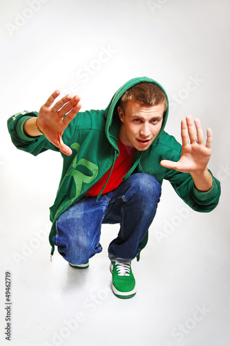 Portrait of hip hop style dancer posing isolated on white backgr