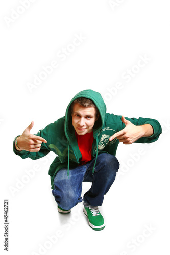 Portrait of cool hip hop style dancer posing isolated on white b