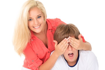 Girl covering young man's eyes