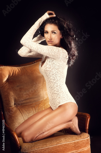 Beautiful Brunette Woman in White Clothing posing - Sensual Styl