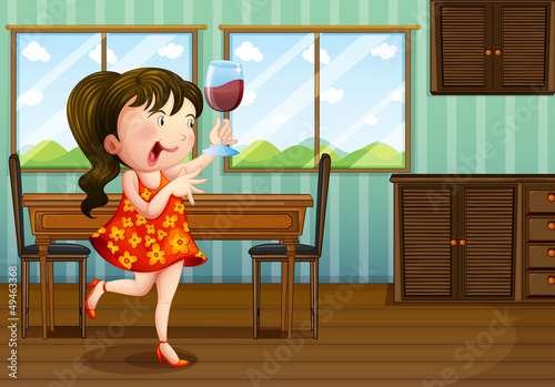 A girl holding a glass of wine