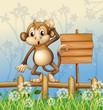 A monkey standing in a fence beside an empty board
