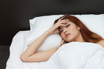 woman sleep and hold her head with stress or sickness