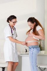Pregnant woman and doctor.